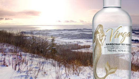 Virga Vodka overlooking snowy Nova Scotia shoreline
